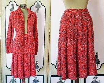 1960's Mid-Century Orange Speckle Knit Skirt Suit. Medium to Large.