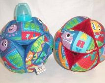 Monster Print Baby Bottle Holder Ball
