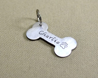 Personalized aluminum dog bone dog tag with custom names, phone numbers, or messages - DT560