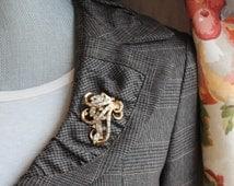 Vintage Trifari Pat Pending Crystal Rhinestone Golden Swirl Brooch