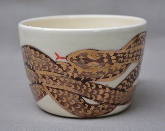 Overlapping snake handmade hand painted black and gold on white ceramic art mug