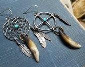 Sköll and Hati. The Wolves who chase sun and moon. Asymmetrical Sterling tribal earrings Spirit Wheel & Dreamcatcher Coyote Teeth Feathers
