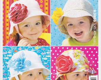 Kwik Sew Pattern K3989 Lined Hats with Fabric Flower Embellishments, Top-Stitched Brim, and Chin Strap Babies & Toddler Sizes XXS-XS-S-M-L