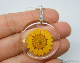 1 Yellow dried flower resin pendant silver plated tone NB17