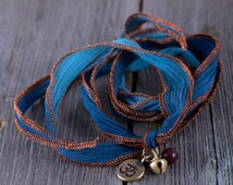 Yoga Bracelet With Antique Brass Bell, ohm charm and mookaite bead, wrapping bracelet, boho chic, wrapping, blue, rust, red, brass charms