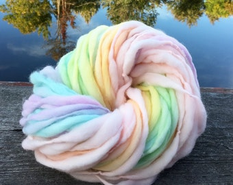 Handspun yarn pastel rainbow, 62 yards and 3.5 ounces/ 100 grams, self striping, thick and thin in merino wool