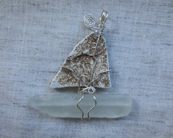 Old authentic Hudson River NY beach pottery and sea gass silver plated wire wrap sail boat ornament. Lot of 1 ornament.