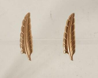 vintage men's feather cufflinks by Swank