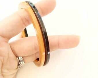 Antique Bakelite bangles bracelets dark green and orange set of 2 bangles bracelets