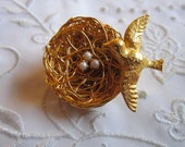 Vintage Rare Gold Tone Nest with Bird and Faux Pearl Eggs Brooch by Jeanne