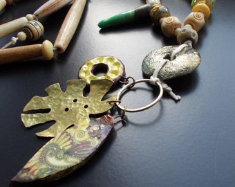 Tribal Talisman Necklace with handmade ceramic charms, handmade vintage brass leaf, artisan lampwork, bone pipe beads and horn.