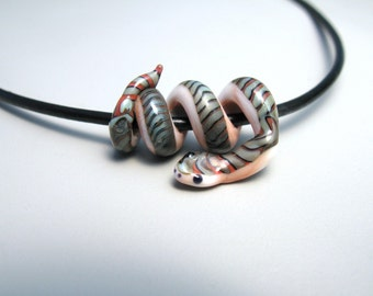 SALE Peach and Jade Snake Glass Lampwork Bead on black cord necklace in gift box