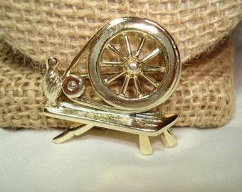 1960s Spinning Wheel Pin.