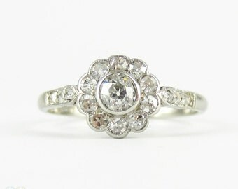 Antique Engagement Ring, Old European Cut Diamonds in Floral Cluster Daisy Shape. 0.43 ctw, Platinum Ring, Circa 1910s.