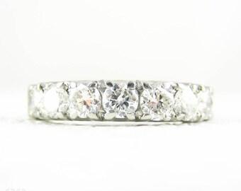 Vintage Diamond Wedding Ring, Platinum Mid 20th Century 7 Stone Diamond Anniversary Band. 0.63 ctw, Circa 1950s.