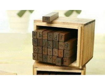 Wooden Stamps Lowercase Uppercase Letter in wood container  with 1 inkpad