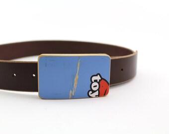 Skateboard belt buckle
