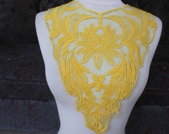 Yellow  color embroidered applique 5 1/2 inches wide at the neck 3 inches wide at the shoulder 13 inches long center down