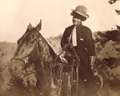 Real COWGIRL On Her HORSE With Cowboy Hat Casting Shadow Photo Postcard circa 1910