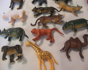 lots of vintage rubbery toy animals