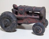 Cast Iron Toy Tractor with Red Chippy Paint Original Wheels