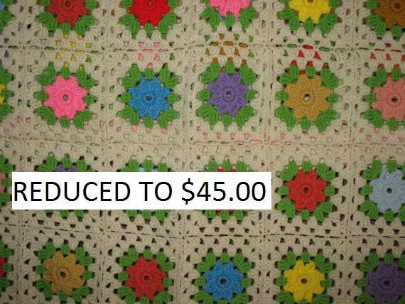 Afghan is called Springtime it has many different  colored flowers.  Ready to ship.