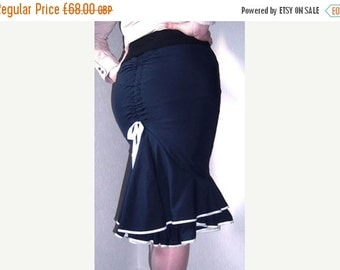 25% OFF Double frill fishtail skirt with ruched back seam and adjustable bow
