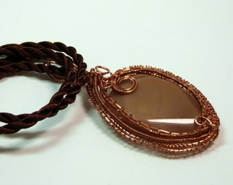 Woven- Wire Wrapped stone/pendant with copper wrappings, caramel colored natural stone