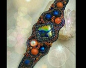 NEBULA; A Star is Born. Bead Embroidered Cuff Dichroic focal Czech beads, rubber tubing, O beads, midnight blue