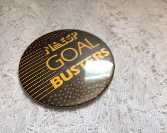 Vintage NESP Goal Busters Pin Back Yellow and Black Metal Collectibles 3 InchesButton Souvenor