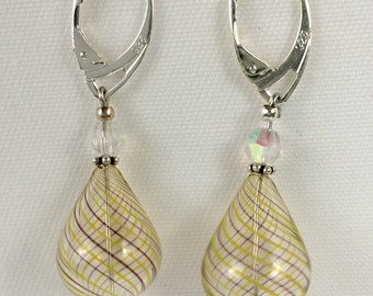 Light and lovely handblown yellow and purple striped teardrop glass earrings.