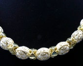 Unusual white beads etched in gold necklace