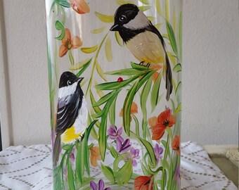 Glass vases with chickadee