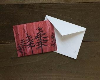 spruce tree silhouette in alaskan wildfire greeting card