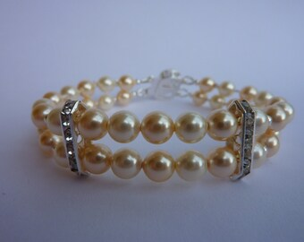 Pearl bracelet: double strand light cream and champagne gold Swarovski pearls, rhinestone spacers and filigree box clasp ideal bridal wear