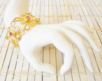 Retro Avon Bold Flower Bracelet, Pink Rhinestones, Golden Links, Wide bracelet, Baroque, 1960's style, made in the 90's