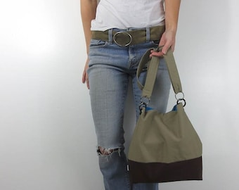 leather purse. adjustable strap cross body bag with leather bottom base and choice of top fabric. design your own.
