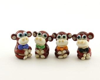 Monkey With bow tie / in skirt artisan  monkey bead glass lampwork brown  ivory / sculpture / miniature / figurine