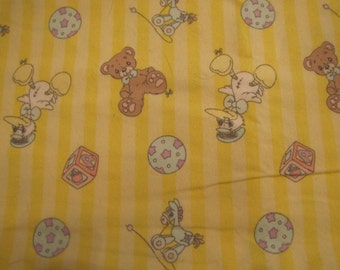 Precious Moments flannel fabric - yellow/white stripe with precious moments characters - you are buying by the yard.