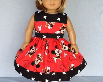 Fits American girl doll or 18 inch doll. Dress and hair clip from novelty Mickey Mouse prints.