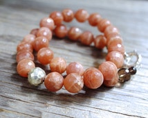Chunky sunstone necklace with hammered sterling silver bead off side. Peach gemstone statement necklace. Faceted sunstone beaded necklace.