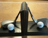 Golf club bookends with golf balls