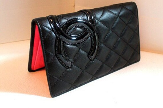 0cfee8cf5ac5 How about this fake Chanel leather wallet pretending to be
