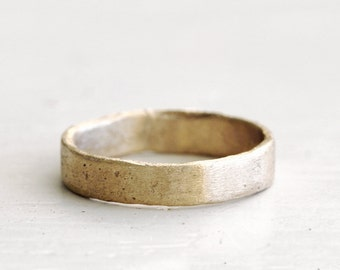 A roughed up gold wedding band. 18k. Big Lulu