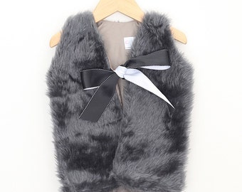 Girls Faux Fur Vest with black ribbon.