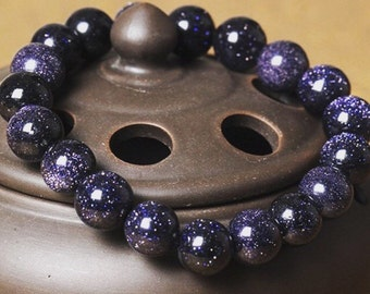 Wear your universe around your wrist with the Galaxy bracelet made from real blue goldstone!