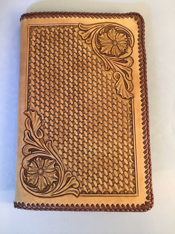 Sheridan style floral carved and basket stamped leather