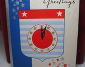 1940's patriotic thmed silver gilded Happy New Year greeting card stars and striped red white blue colors and clock , end of world war 2 era
