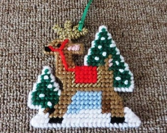 Needlepoint deer in the snow ornament.