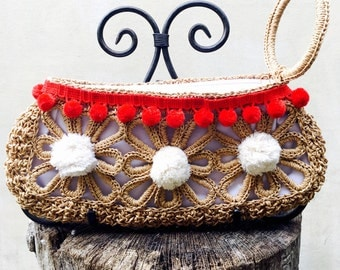 Straw Clutch with red and off-white pompoms.